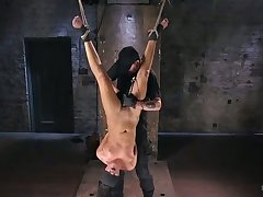 Dude tickles Roxy's twat with a vibrator while she is drape upside down