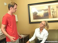 Blonde mature Simone Sonay with glasses milks a young detect on will not hear of
