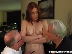 Young redhead battle-axe drops on her knees to please two old dicks