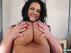 Brunette mature shakes giant boobs on webcam