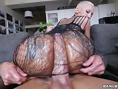 Tattooed pornstar Bella Bellz drops her thong for anal sex